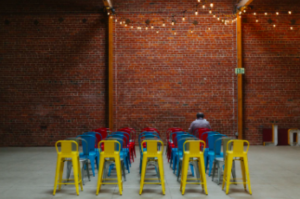 colourful chairs and one person sitting there